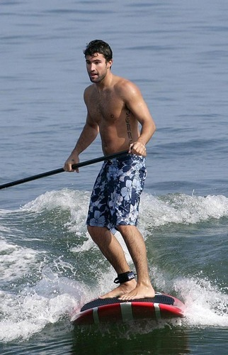 Brody surfing in Malibu