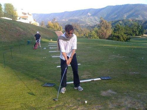 Matthew golfing