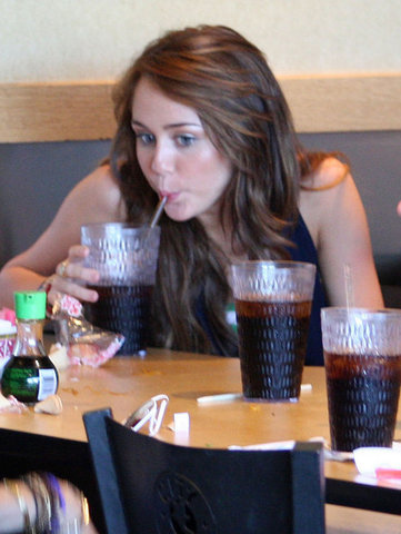 miley cyrus at a restaurant