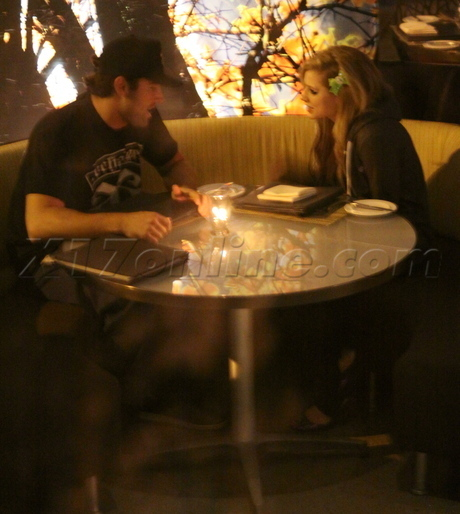 Avril and Brody at a restaurant