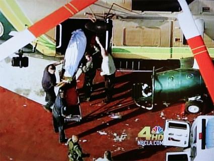 Body bag and the Coroner van
