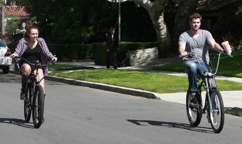 Miley Cyrus And Liam Hemsworth Out For A Bike Ride