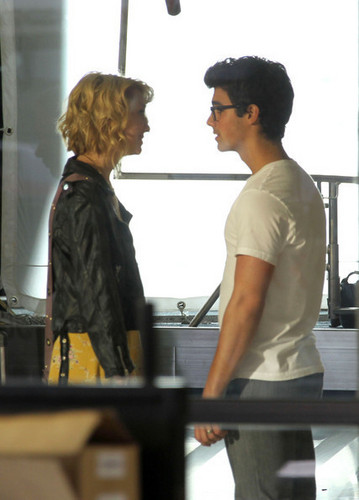 Joe Jonas&Chelsea Staub film scenes for the upcoming Jonas TV tunjuk for the Disney Channel@LA airport