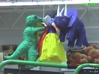 Snow White being attacked oleh dinosaurs.