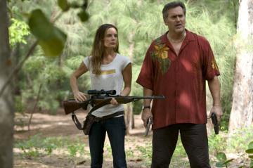 Fiona and Sam w/guns