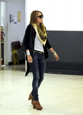 Miley Cyrus arriving at LAX Airport (6.7.10)