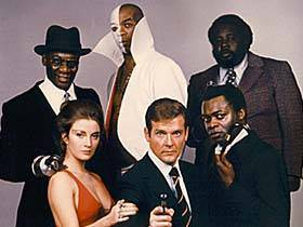 Roger Moore with the Cast of James Bond - The Man with the Golden Gun