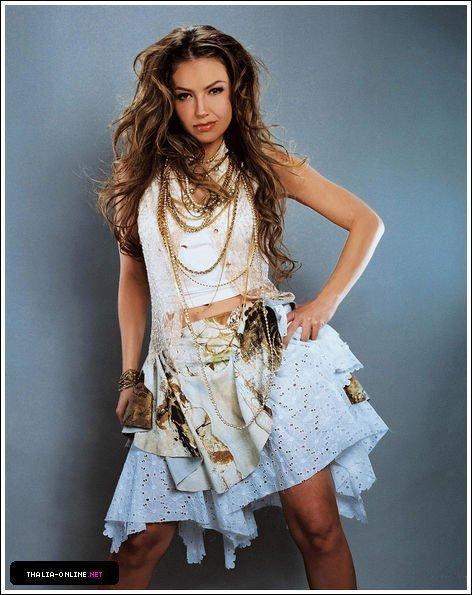 http://images2.fanpop.com/image/photos/13000000/Thalia-thalia-13098057-472-595.jpg