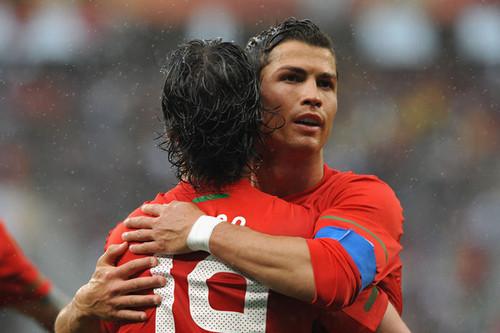 Hugo Almeida of Portugal celebrates scoring his side's third goal with captain Cristiano Ronaldo