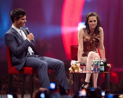 Kristen Stewart and Taylor Lautner promoting in Stockholm (June 21).