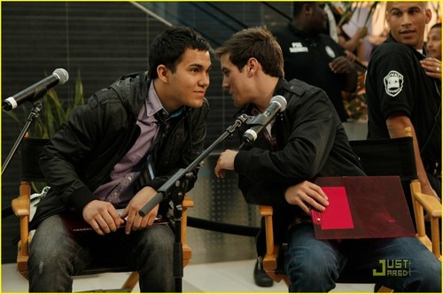 Logan whispering to Carlos