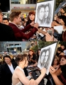 Robert Pattinson and Kristen Stewart sign fan art at the 'Eclipse premiere' - twilight-series photo