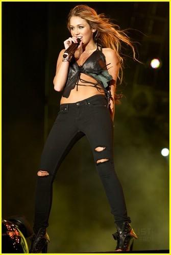 http://images2.fanpop.com/image/photos/13600000/Miley-Rock-in-Rio-miley-cyrus-13686882-335-500.jpg