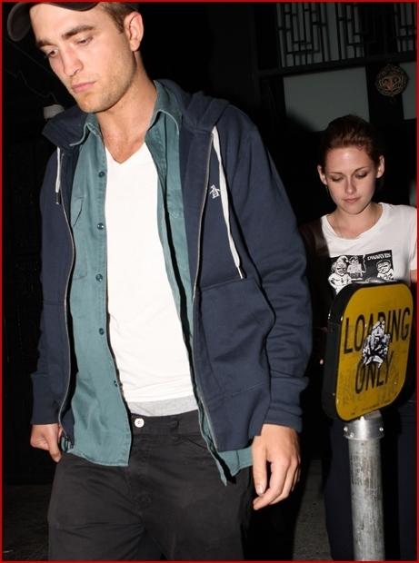 Rob and Kristen leaving Sam's concierto last night