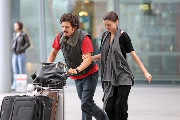 Orlando Bloom and Miranda Kerr at Heathrow Airport (July 9)