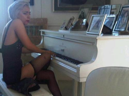 Lady Gaga playing John Lennon's old piano.