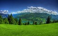 grassy field; distant mountains - beautiful-places photo