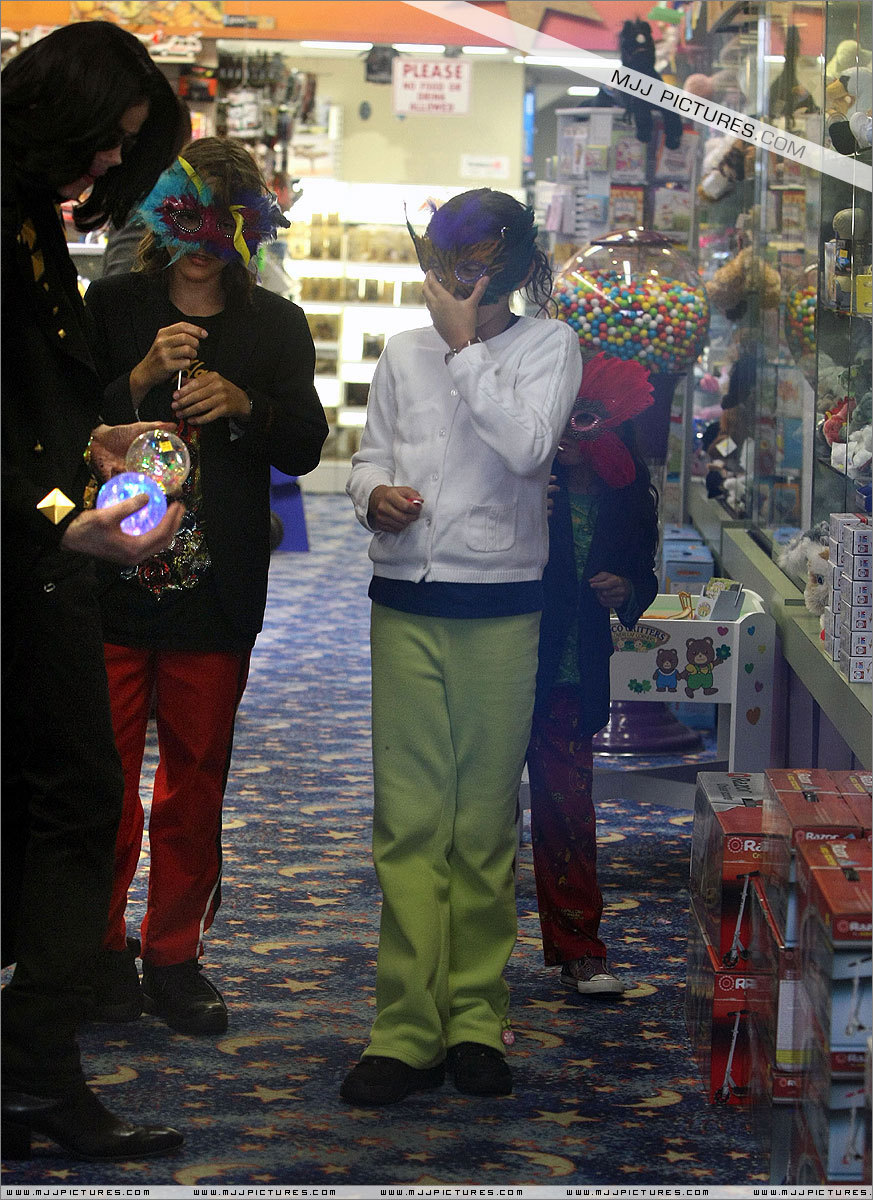 Michael shopping with his kids at Tom's Toys