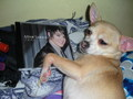 My dog holding Adam's cd <3