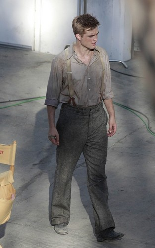 "Robert Pattinson with his bitten hand on the set of ""Water for Elephants"" (July 28)."