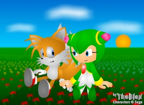 Tails sitting susunod to Cosmo
