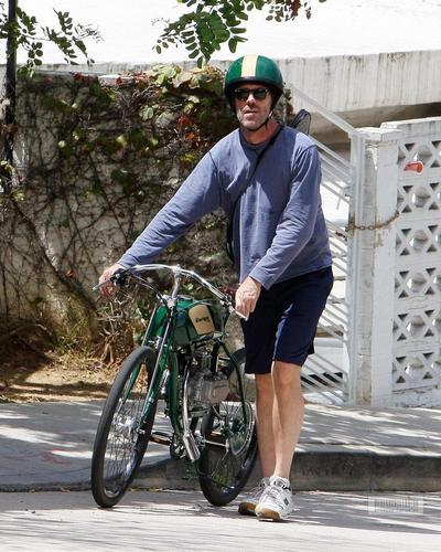Hugh Laurie- Hugh Laurie- Riding his motorcycle in Hollywood Hills, August 1st
