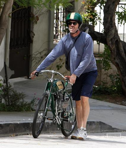 Hugh Laurie wallpaper titled Hugh Laurie- Riding his motorcycle in Hollywood Hills, August 1st