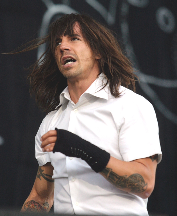 Red Hot Chilli Peppers' Anthony Kiedis holds hands with ...
