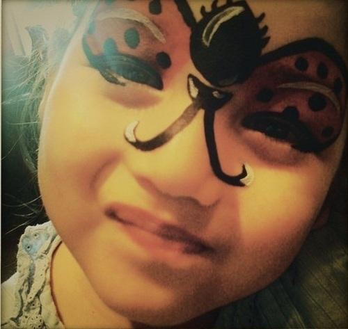 Nessie with ladyb bird facepaint on