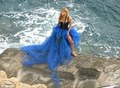 Work it: Wearing a flowing blue creation, the 별, 스타 posed for pictures on the rocks