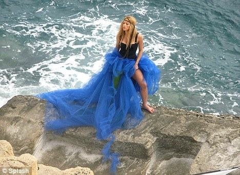 Work it: Wearing a flowing blue creation, the nyota posed for pictures on the rocks
