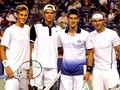 Vasek Pospisil and Milos Raonic of Canada pose for photographers with Novak Djokovic and Rafa Nadal