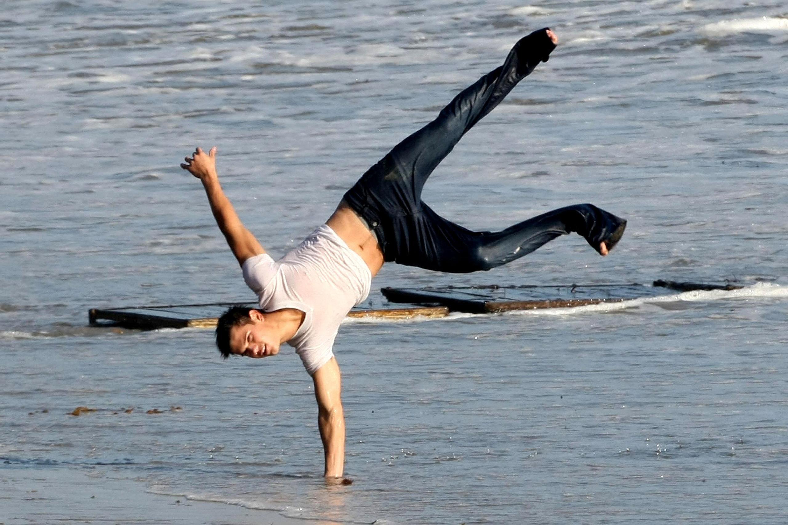 Taylor Lautner flips for Rolling Stones