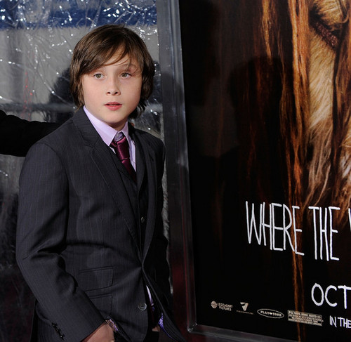 Where The Wild Things Are wolpeyper with a business suit, a suit, and a sign titled 'Where The Wild Things Are' Premiere in New York on October 13, 2009: Max Records