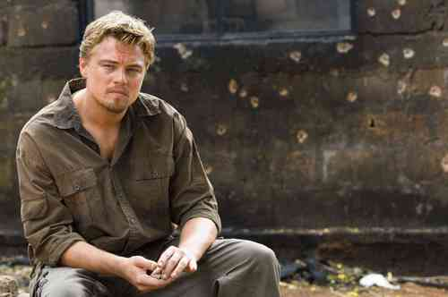 Leonardo DiCaprio वॉलपेपर probably containing a business suit titled Blood Diamond