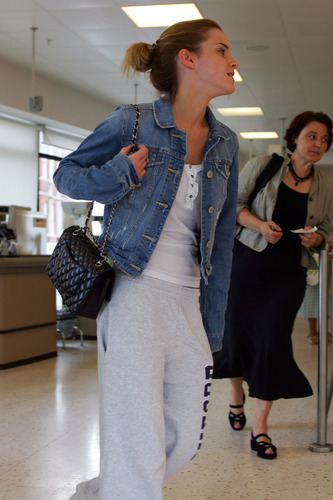 Emma Watson: At Waitrose in Finchley with geai, jay Barrymore [07.15.09]