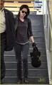 Kristen Stewart makes her way through LAX airport in Los Angeles - twilight-series photo