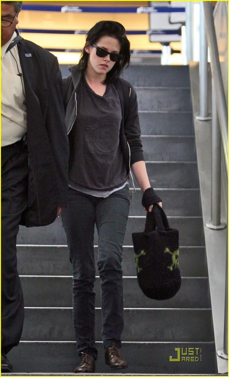 Kristen Stewart makes her way through LAX airport in Los Angeles