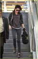 Kristen Stewart makes her way through LAX airport in Los Angeles - twilight-series photo