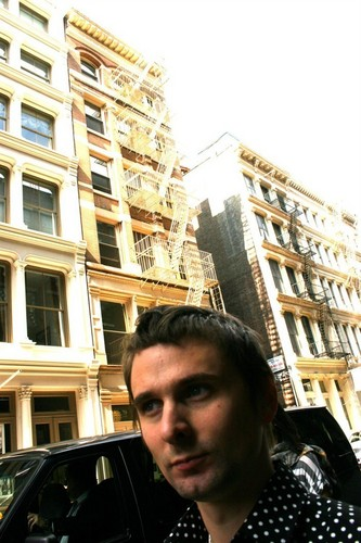 Matthew Bellamy achtergrond containing a brownstone, a street, and a row house entitled Matt