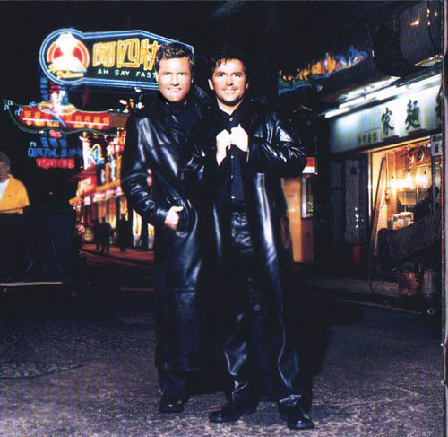 Modern Talking Hintergrund probably with a well dressed person, a box coat, and a business suit called Modern Talking (Thomas Anders / Dieter Bohlen)