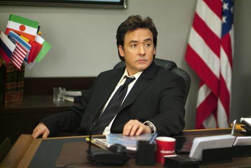 John Cusack Hintergrund containing a business suit, a suit, and a well dressed person called War, Inc