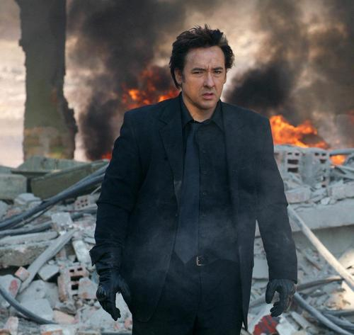 John Cusack wallpaper with a fire and a business suit entitled War, Inc