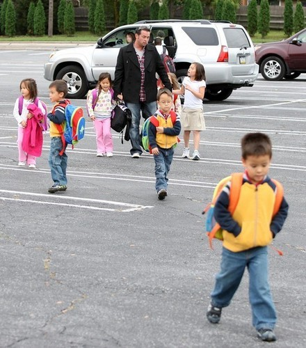 jon picing up his kids from the bus stop