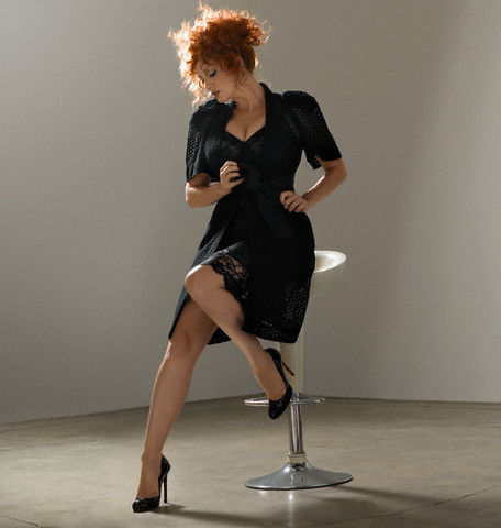 Christina Hendricks wallpaper possibly with hosiery, bare legs, and a hip boot titled Christina Hendricks | Esquire Photoshoot