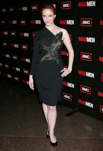 Christina Hendricks wallpaper probably containing a sign called Christina Hendricks | Mad Men Season Three Premiere