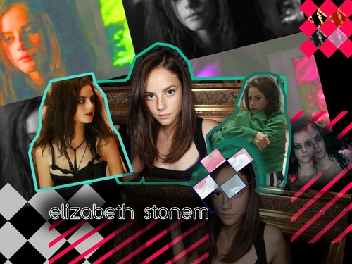 Effy Stonem Обои probably with a sign, a street, and a business suit entitled Effy Stonem - Обои