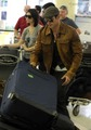 Kellan Lutz & Ashley Greene leave Vancouver  - twilight-series photo