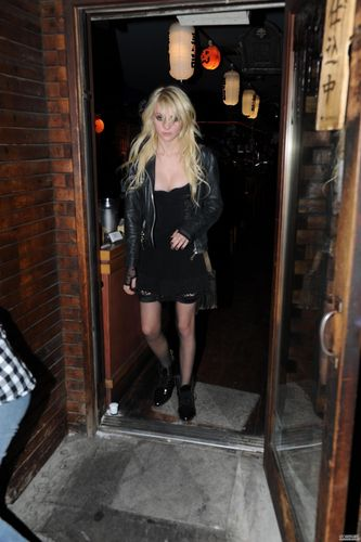 Taylor Momsen wallpaper possibly with a revolving door and a hip boot entitled TM.