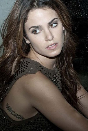 http://images2.fanpop.com/image/photos/8700000/nikki-reed-photo-shoot-twilight-series-8730466-304-450.jpg